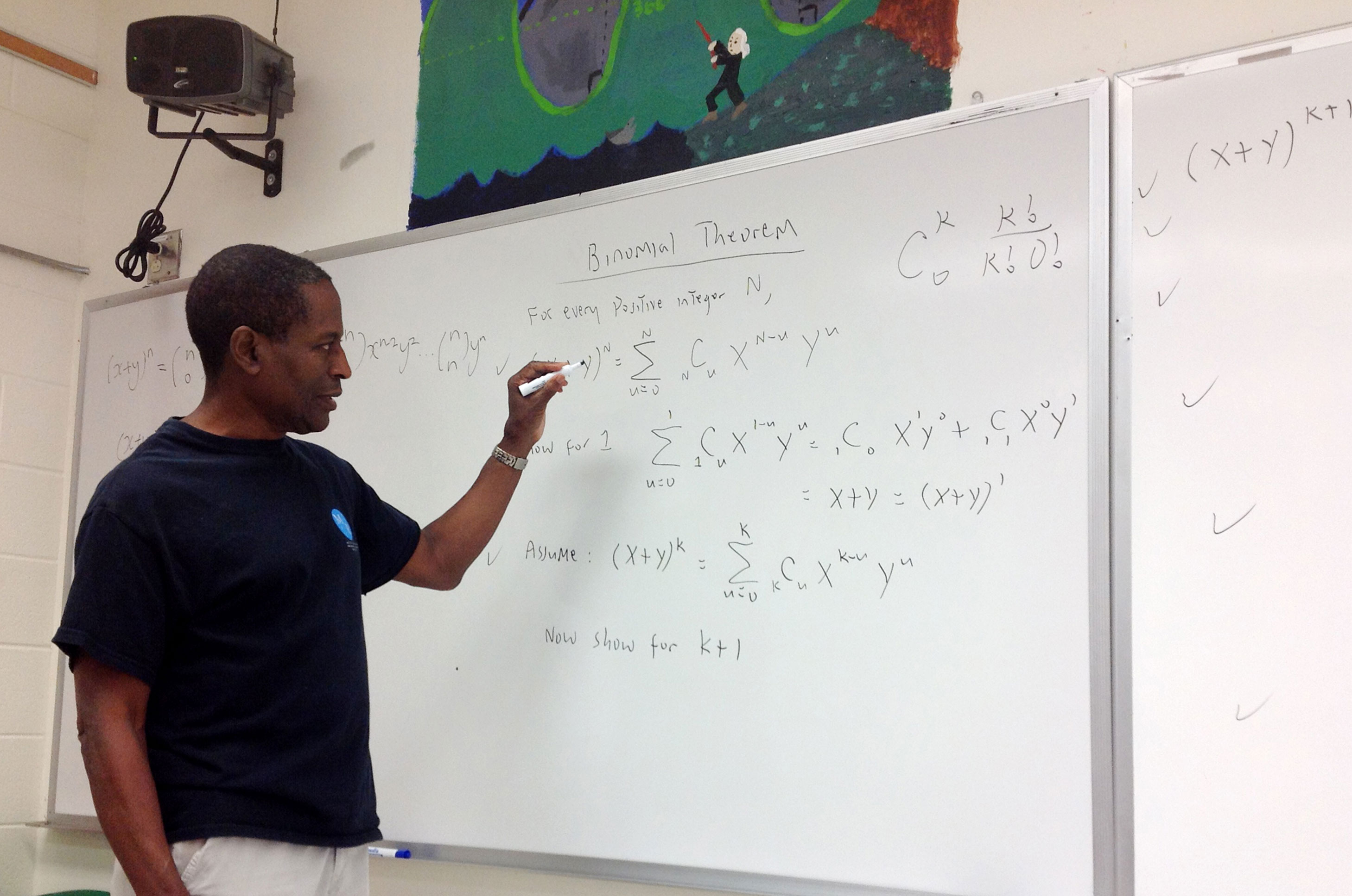 teacher writing on board